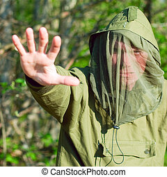 Man in encephalitis protective clothing - Man wearing...