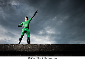 Superhero pointing with dramatic background - Green...
