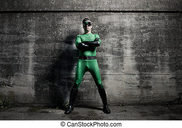 Confident superhero standing with arms crossed against a...