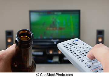 Couch Potato - This image is of a manwoman sipping some beer...