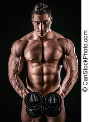 abdominals - Portrait of a handsome muscular bodybuilder...