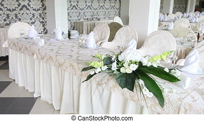 wedding hall with tables decorated with flowers - wedding...
