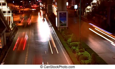 Speed up Timelapse. Night traffic on the road. City lights. Background with blurring bokeh. HD. 1920x1080