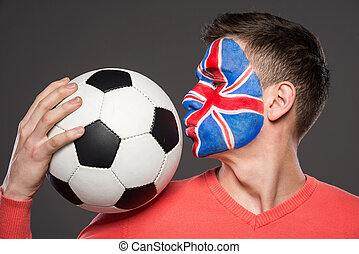Face art. Flags. - Young man with flag painted on his face...