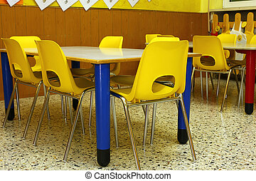 classroom of a school with the little yellow chairs -...