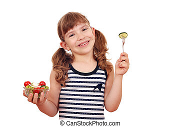happy little girl with healthy salad