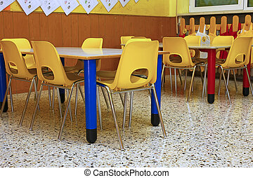 yellow chairs and benches of a school for young children -...