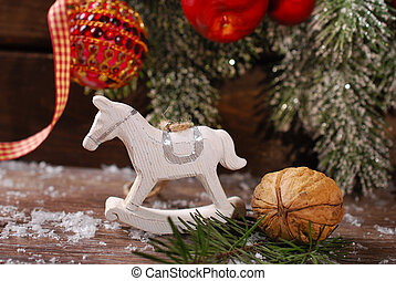 christmas decoration with rocking horse toy on wooden backgroun