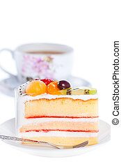 Fruit cake with a cup of coffee - Slice of beautiful cake on...