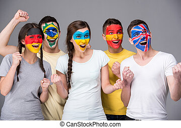 Face art. Flags. - International team. Five emotional young...