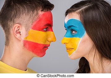 Face art Flags - Two young fans with the flags of their...