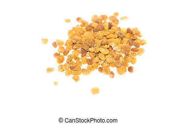 Top view of bee pollen against bright white background -...