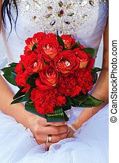 Wedding day - The bride holds a wedding bouquet