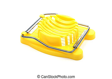 Yellow plastic egg cutter isolated on white background. Studio shot.