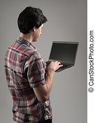 rear view of a man with laptop - rear view of a casual man...