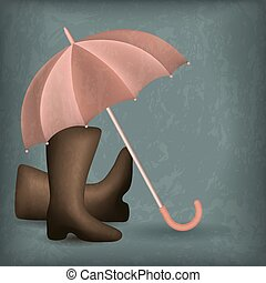 Opened rain umbrella and rubber boots on the shabby...