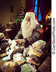 Santa Claus using a vintage calculator