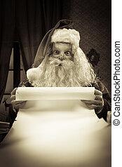 Santa with a long Christmas list - Santa Claus reading a...