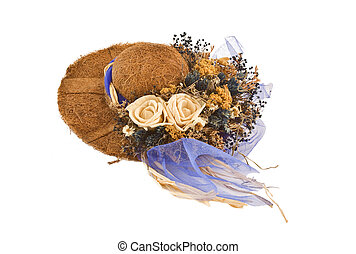 Decorative hat with fake flowers on top of it