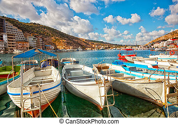 Boats in Balaklava Bay in the sunny summer day, the Crimea