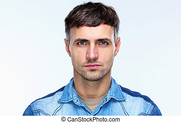 Portrait of a casual serious man over gray background