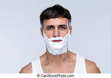 Portrait of handsome man with foam on face