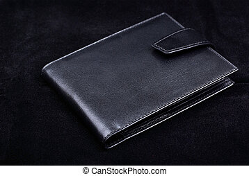 New wallet made of high quality leather isolated on black...