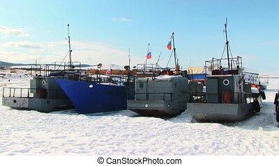 Ships in winter frozen lake