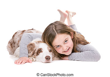 little girl with a border collie