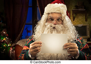 Santa Claus holding a blank card - Happy Santa Claus holding...