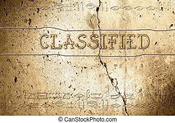 classified - word classified on wall with egyptian alphabet...