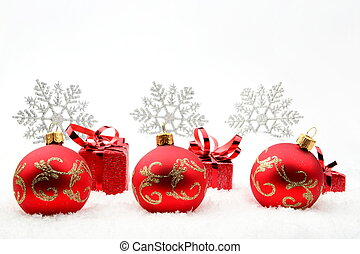 Red christmas gifts and baubles with snowflakes on snow -...