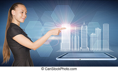 Beautiful businesswoman, tablet pc and spatial layouts of...