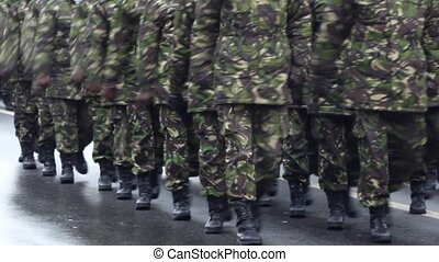 Soldiers Parade - Soldiers marching in cadence at an army...