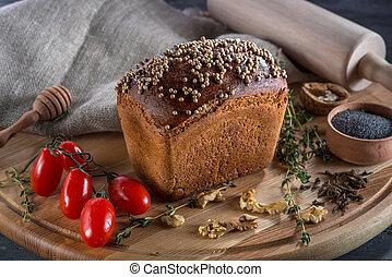 Borodino bread on wooden board - Borodino bread with...