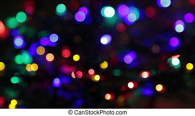 blurred christmas lights abstract background on black
