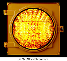 Illuminated amber traffic light - Close up of illuminated...