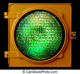 Illuminated green traffic light - Close up of illuminated...