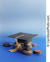 grad cap and coins - Mini graduation cap on assorted coins...