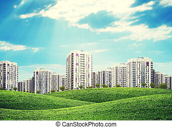 high-rise buildings over green hills - high-rise buildings...