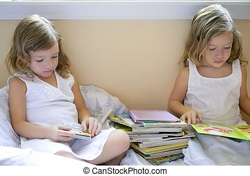 Beautiful twin little girls doing homework - Beautiful twin...
