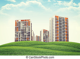 Few high-rise buildings of same design over green hills....