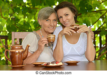 Older woman with her adult daughter