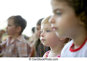 Spectator children looking at the show