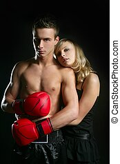 couple of blond girl and handsome boxer man - Young...