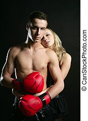 Sexy young male boxer with blond beautiful girl, isolated on...