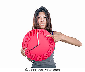 Asian woman holding clock - Chinese woman looking worried,...