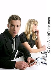 young  business couple over white