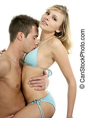Young sexy couple hug over white background - Young sexy...