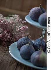 Figs on a cake stand - Ripe figs on a cake stand closeup
